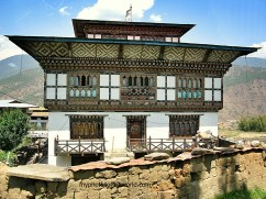 Houses in Bhutan are painted with religious images believed to protect it from evil spirits.